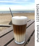 drinking latte macchiato on the ... | Shutterstock . vector #1222859071