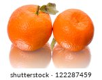 Two tangerines with leaves. Isolated on a white background - stock photo