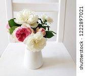 beautiful garden roses in vase... | Shutterstock . vector #1222897021