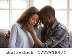 Small photo of Loving African American husband touching wife face with tender, apologizing after quarrel, man comforting woman, health problem, interruption unwanted pregnancy, miscarriage, relationships trouble