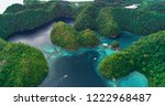 Small photo of Aerial view of Sugba lagoon. Beautiful landscape with blue sea lagoon, National Park, Siargao Island, Philippines.