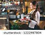 waiter serving in motion on... | Shutterstock . vector #1222987804