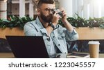 young bearded hipster man with... | Shutterstock . vector #1223045557