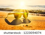sun's rays cut through the... | Shutterstock . vector #1223054074