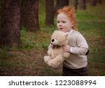 red haired boy in autumn | Shutterstock . vector #1223088994