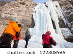 Man Supports Climber On Frozen...