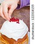 Christmas creamy cake decorated by hands with violet sleeve - stock photo