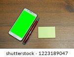 smartphone with green... | Shutterstock . vector #1223189047