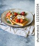 belgian waffles with cream ...   Shutterstock . vector #1223223334