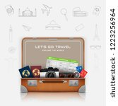 open suitcase with vacation... | Shutterstock .eps vector #1223256964