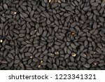 black cumin seeds.top view.... | Shutterstock . vector #1223341321