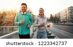 young fitness couple running in ... | Shutterstock . vector #1223342737