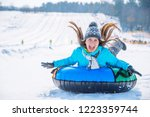 young smiling girl ride sleigh...   Shutterstock . vector #1223359744