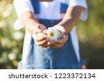 beautiful flowers in child hand ... | Shutterstock . vector #1223372134