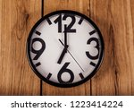 black clock with white dial on... | Shutterstock . vector #1223414224