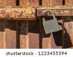 padlock closing rusty metal...   Shutterstock . vector #1223455594