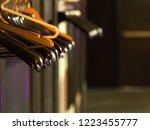 row of empty different hangers... | Shutterstock . vector #1223455777