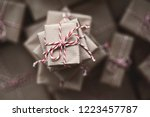 small gift box on top of a pile ... | Shutterstock . vector #1223457787