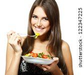 young funny woman eating salad... | Shutterstock . vector #122347225
