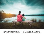 asian mother and her daughter... | Shutterstock . vector #1223656291