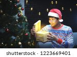 asian man with christmas... | Shutterstock . vector #1223669401