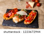 bruschetta with ham parmesan... | Shutterstock . vector #1223672944