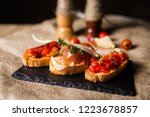bruschetta with ham parmesan... | Shutterstock . vector #1223678857