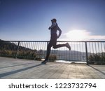 running athlete man  side full... | Shutterstock . vector #1223732794