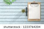 blank sheet of paper on blue... | Shutterstock . vector #1223764204