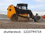mini bulldozer on a gravel road ... | Shutterstock . vector #1223794714
