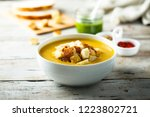 pumpkin soup with cream and... | Shutterstock . vector #1223802721