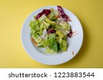 mixed green salad in shallow... | Shutterstock . vector #1223883544
