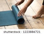 fit beautiful woman folding... | Shutterstock . vector #1223886721