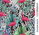 flamingo and tropical leaves on ... | Shutterstock . vector #1223888644