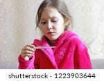 little girl looks at a... | Shutterstock . vector #1223903644
