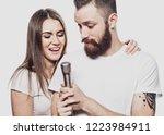 happy couple singing in karaoke ... | Shutterstock . vector #1223984911