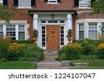 Wooden Front Door Of Home With...