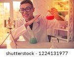 beaming chemist holding.... | Shutterstock . vector #1224131977