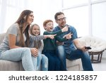 happy family sitting watching... | Shutterstock . vector #1224185857
