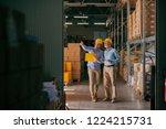 colleagues walking in storage... | Shutterstock . vector #1224215731