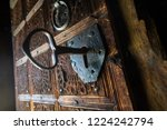 Big Key In Rustic Door Of...
