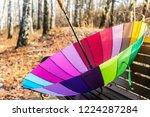 open colored umbrella lying on... | Shutterstock . vector #1224287284