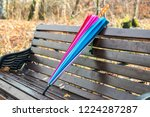 colored umbrella lying on a... | Shutterstock . vector #1224287287