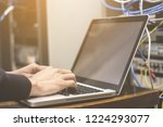 hands man using laptop to check ...   Shutterstock . vector #1224293077