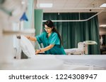 nurse making the bed at a... | Shutterstock . vector #1224308947