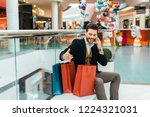 handsome fashionable man with... | Shutterstock . vector #1224321031