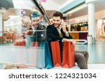 smiling man talking on... | Shutterstock . vector #1224321034