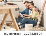 happy young couple using... | Shutterstock . vector #1224325504