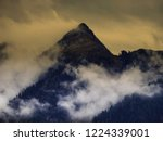 high mountain peak covered by... | Shutterstock . vector #1224339001