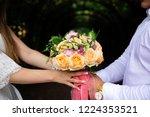 bride holding her bouquet | Shutterstock . vector #1224353521